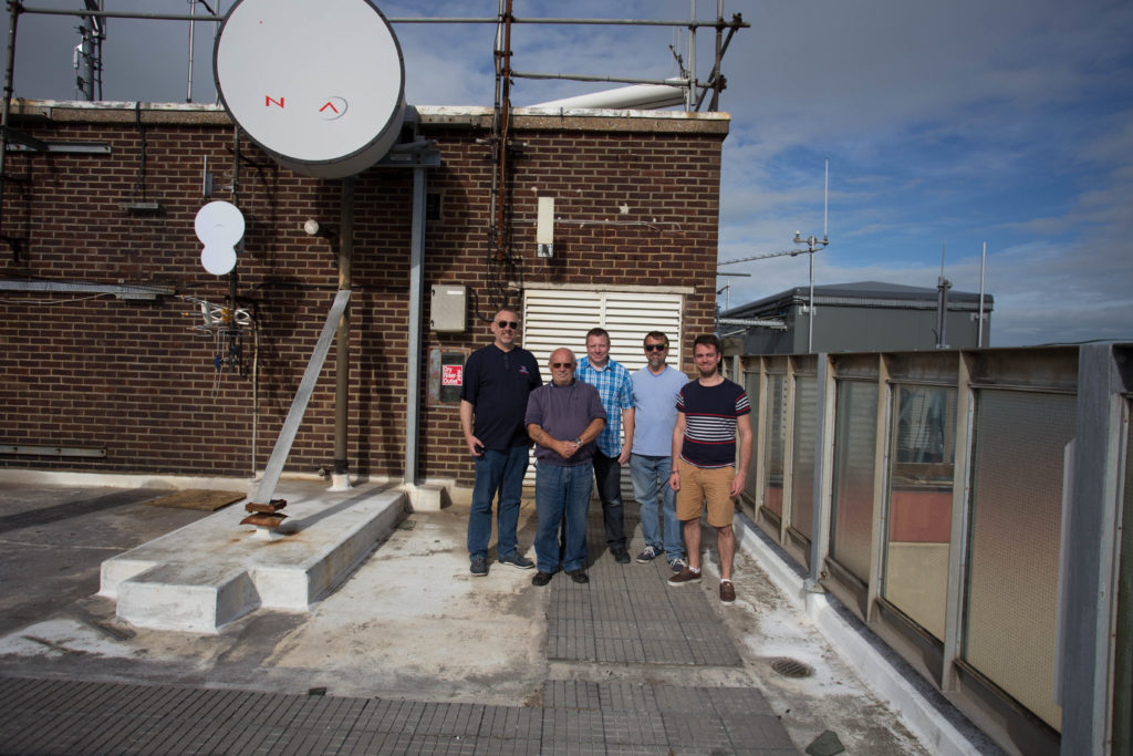 Some of the GB3EK repeater team in front of the repeater room.